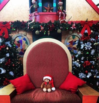 Sammy snuck onto Santa's chair at the mall.
