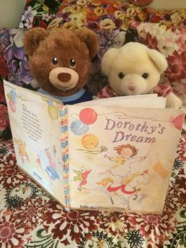 Sammy is reading to Miss, Bear.