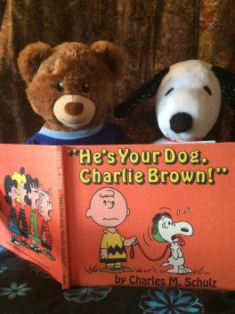 Snoopy is not amused with Sammy's reading choice.